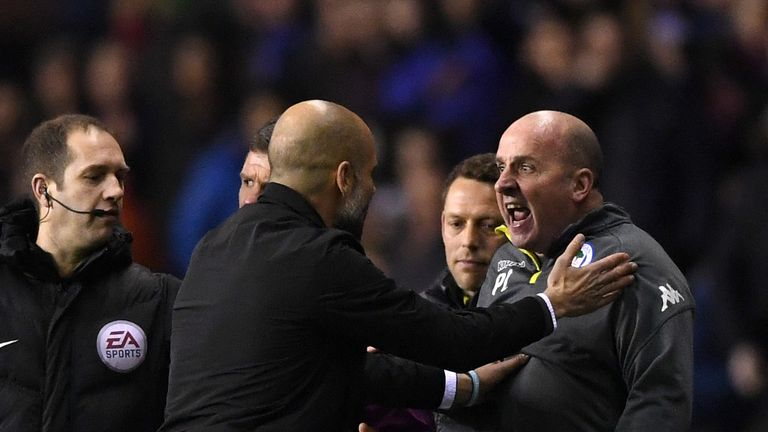 WIGAN, ENGLAND - FEBRUARY 19:  Josep Guardiola, Manager of Manchester City argues with Paul Cook, Manager of Wigan Athletic during the Emirates FA Cup Fift