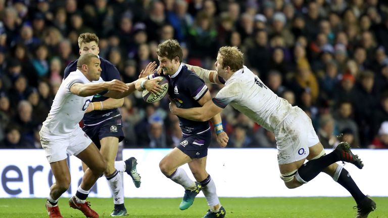 Peter Horne is tackled by England's Joe Launchbury (R) and Jonathan Joseph