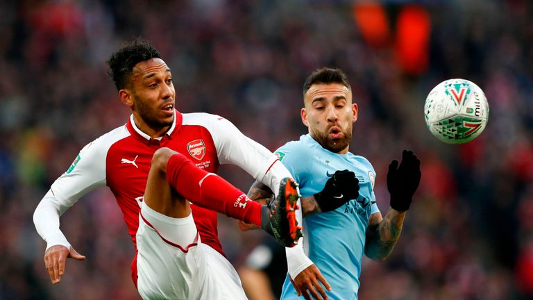Pierre-Emerick Aubameyang and Nicolas Otamendi in action during the Carabao Cup Final