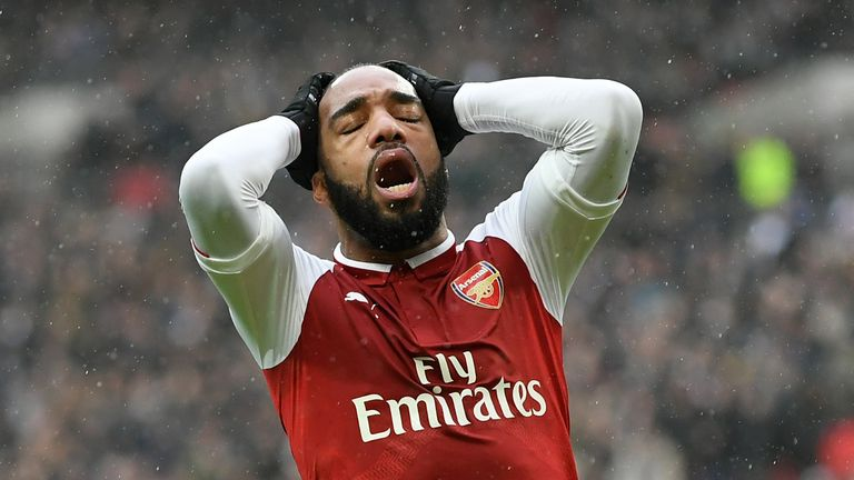 Alexandre Lacazette reacts following a missed chance during the Premier League match between Tottenham Hotspur and Arsenal