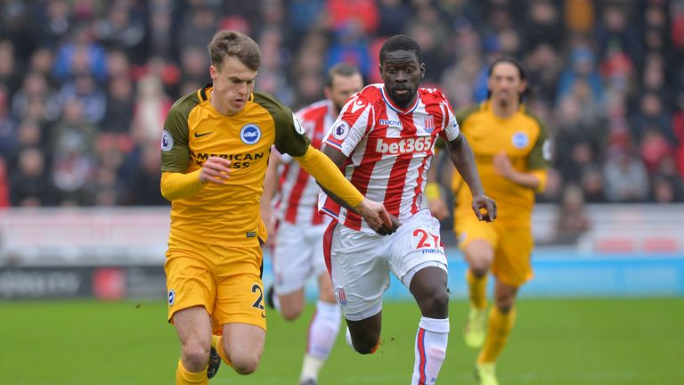 Solly March is chased down by Badou Ndiaye during the Premier League match between Stoke City and Brighton