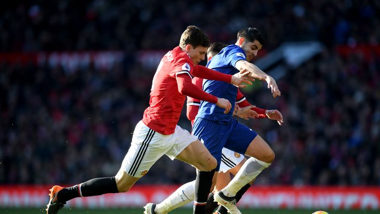 MANCHESTER, ENGLAND - FEBRUARY 25:  Victor Lindelof of Manchester United and Alvaro Morata of Chelsea compete for the ball during the Premier League match