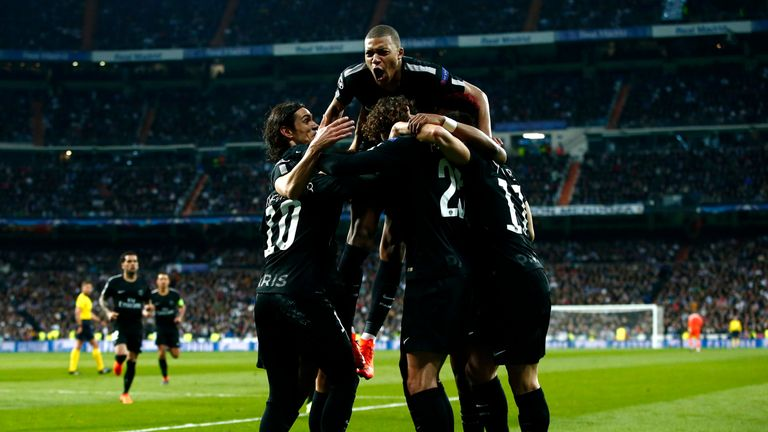 Adrien Rabiot is mobbed by his PSG team-mates after given PSG the lead