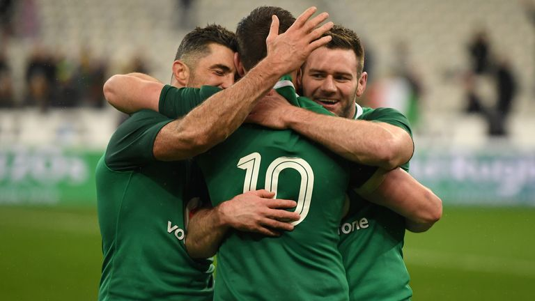 Rob Kearney, Fergus McFadden and Sexton celebrate after securing the victory