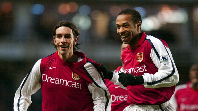 LONDON, UNITED KINGDOM:  Arsenal's French players Robert Pires (L) and Thierry Henry (R) celebrate Pires' equalising goal in the second half during the Pre