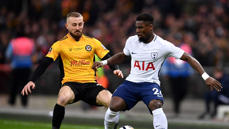 Serge Aurier holds off Dan Butler in the first half at Wembley