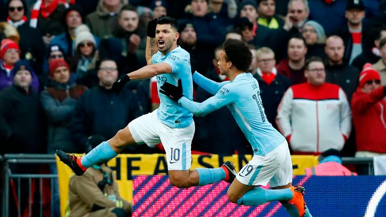 Sergio Aguero celebrates with Leroy Sane after giving Manchester City a 1-0 lead in the Carabao Cup Final
