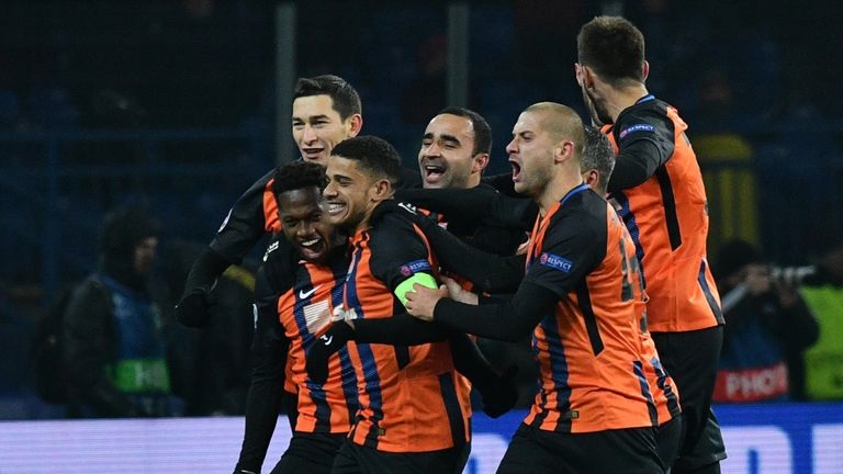 Shakhtar Donetsk's players celebrate the goal scored by midfielder Fred (2L) during the match against Roma