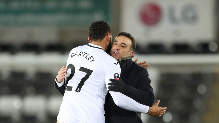 Swansea City's Kyle Bartley and Swansea City manager Carlos Carvalhal celebrate after the final whistle of the Emirates FA Cup, fifth round replay match at