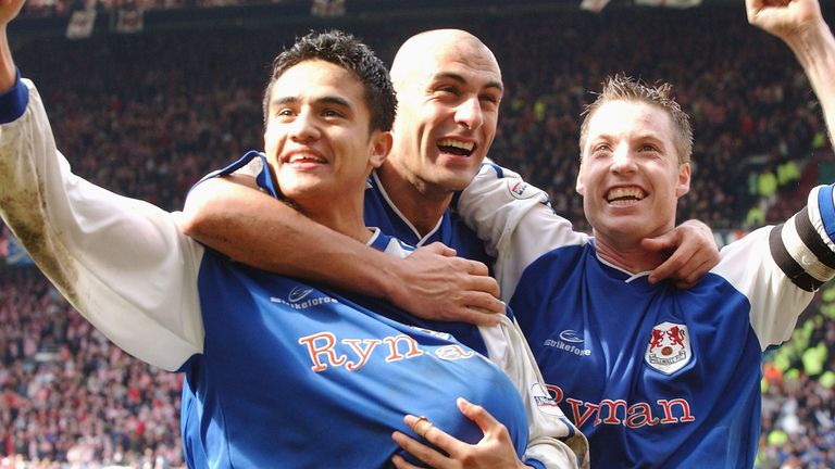 Cahill, Daniele Dichio and Neil Harris celebrate after winning the FA Cup match between Sunderland and Millwall at Old Trafford back in 2004