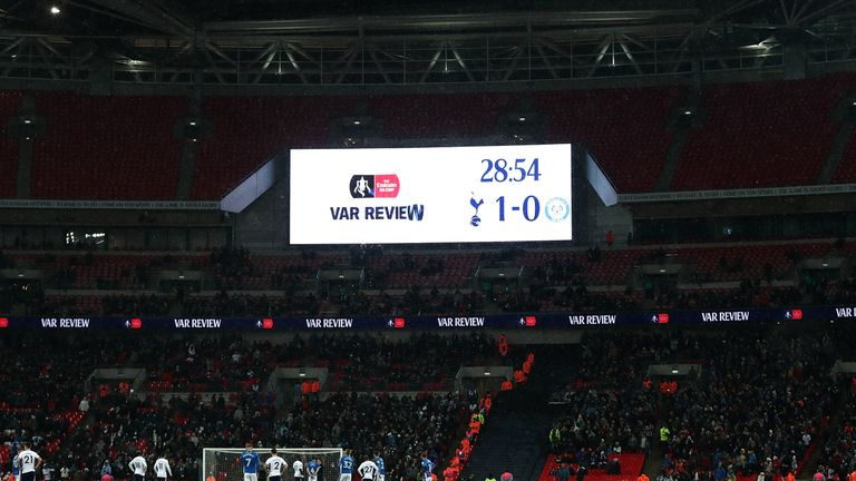 A decision is reviewed by VAR during FA Cup fifth round replay between Tottenham and Rochdale