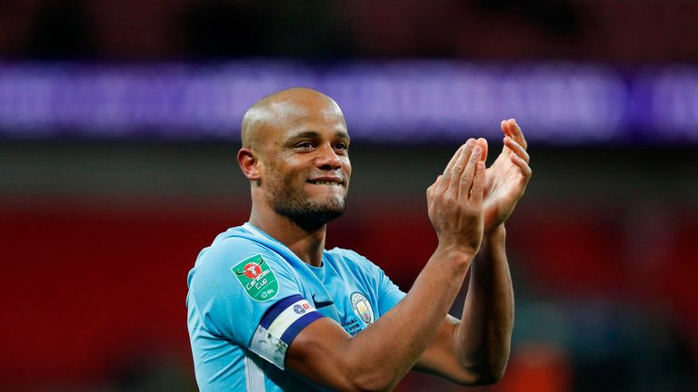 Vincent Kompany celebrates on the pitch after winning 3-0 against Arsenal in the Carabao Cup Final
