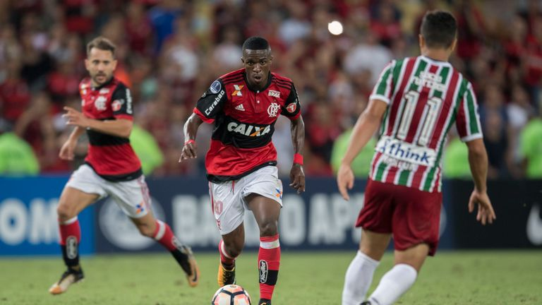 Brazil's Flamengo player Vinicius Jr (L) vies for the ball with Brazil's Fluminense player Marlon (R) during their 2017 Sudamericana Cup football match at