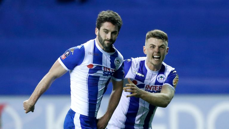 Wigan Athletic's Will Grigg (left) celebrates scoring his side's first goal of the game during the Emirates FA Cup, Fifth Round match at the DW Stadium, Wi