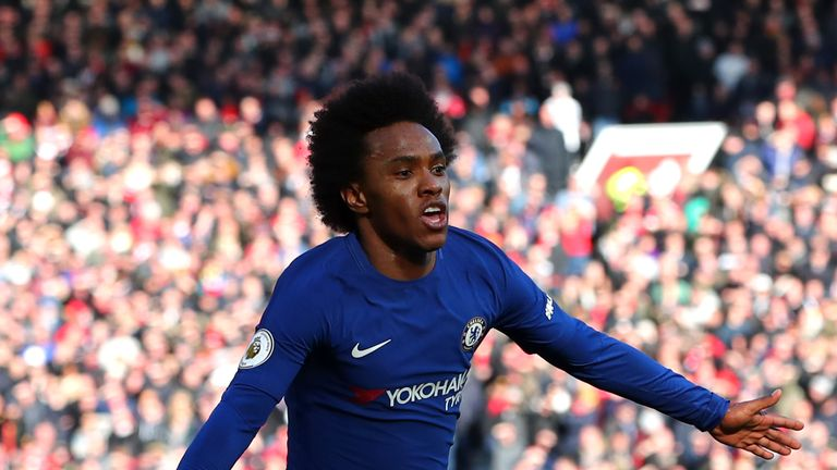 MANCHESTER, ENGLAND - FEBRUARY 25:  Willian of Chelsea celebrates after scoring his sides first goal during the Premier League match between Manchester Uni