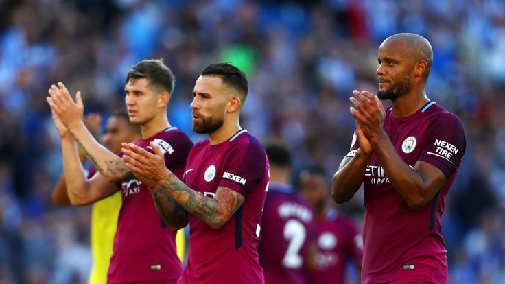 John Stones, Nicolas Otamendi and Vincent Kompany during the Premier League match between Brighton and Hove Albion and Manchester City