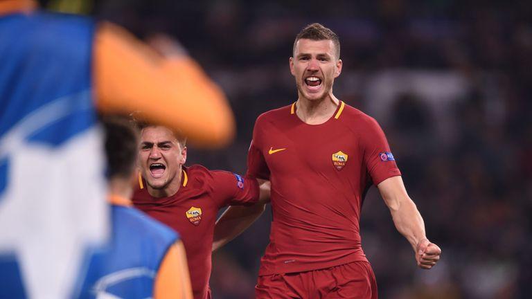 Edin Dzeko celebrates after scoring for Roma