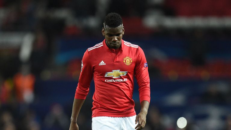A disconsolate Paul Pogba cuts a forlorn figure after Man Utd's Champions League exit
