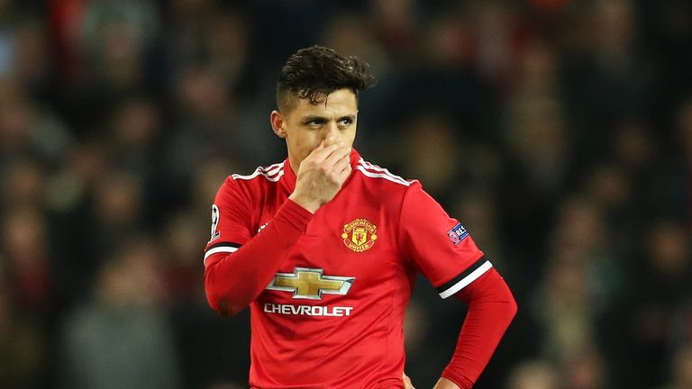 Alexis Sanchez looks disconsolate during the defeat to Sevilla
