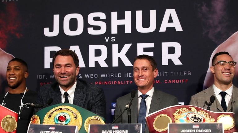 Anthony Joshua alongside his promotor Eddie Hearn, Joseph Parker (right) and his promotor David Higgins (second right) during a press conference