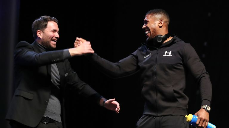 Anthony Joshua and promoter Eddie Hearn on stage during the Joshua v Parker weigh-in at the Motorpoint Arena in Cardiff