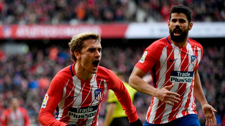 Antoine Griezmann (L) has been linked with a move to Barcelona