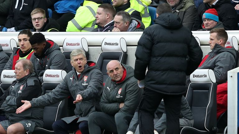 Arsene Wenger gestures on the touchline at the Amex Stadium
