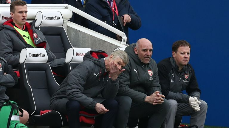 Arsene Wenger looks on dejected as his Arsenal side trail to Brighton
