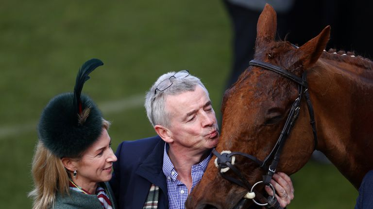 Michael O'Leary plants a kiss on the nose of Balko Des Flos after victory in the Ryanair Chase