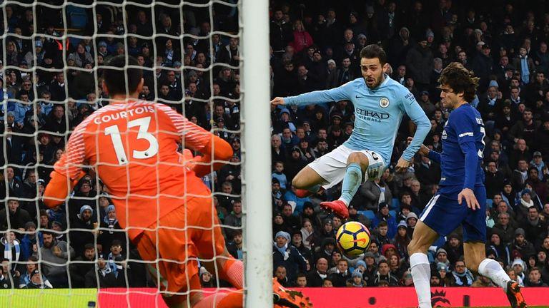 Bernardo Silva (C) scores the opening goal for Manchester City against Chelsea