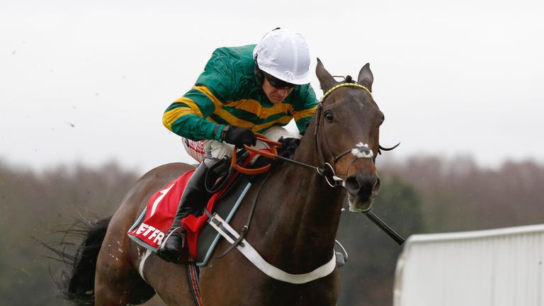Buveur D'Air and Barry Geraghty pull away from the last flight before going on to win The Betfred 'Supports Jack Berry House' Contenders Hurdle Race during Betfred Day at Sandown Park Racecourse