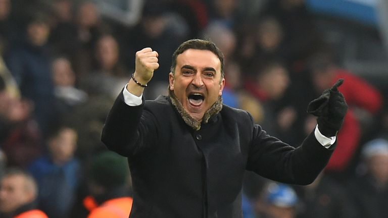Carlos Carvalhal celebrates Swansea's 0-0 draw with Huddersfield