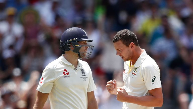 Malan, left, is dismissed by Josh Hazlewood in the Ashes