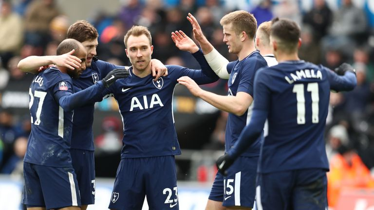Christian Eriksen is congratulated after scoring his second and Tottenham's third