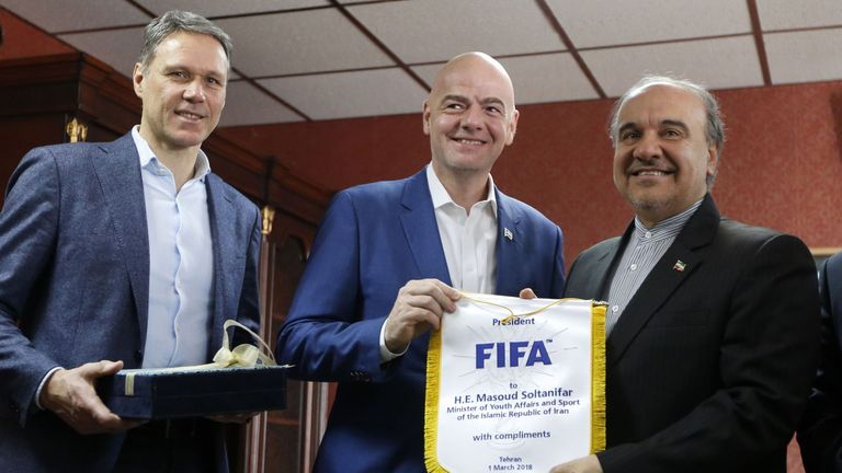 Iran's minister of sport and Youth Masoud Soltanifar (R) poses for a picture with FIFA president Gianni Infantino (C)