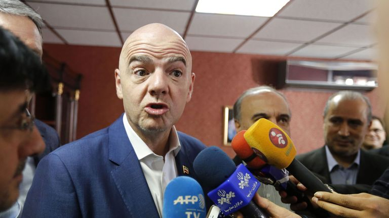 Gianni Infantino speaks to reporters in Iran