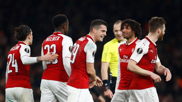 Arsenal secured their place in the Europa League last eight with a 3-1 second-leg win over AC Milan