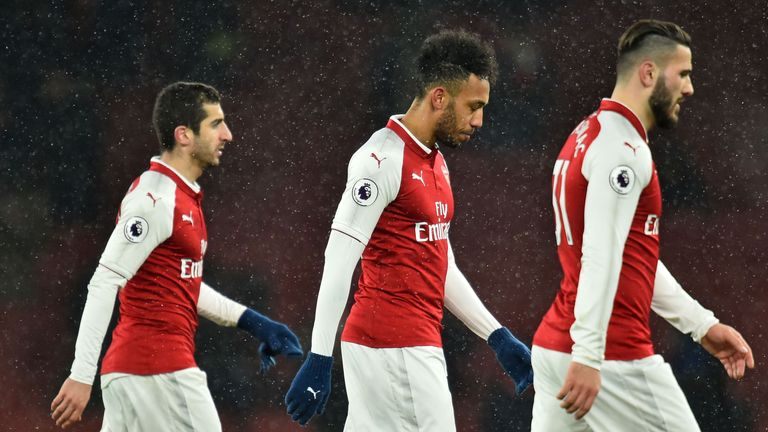 Arsenal players show their dejection during the 3-0 defeat