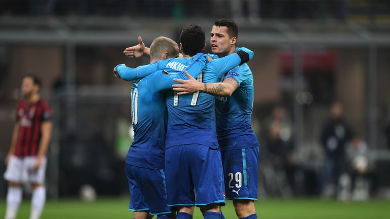 MILAN, ITALY - MARCH 08: Henrikh Mkhitaryan celebrates scoring Arsenal's 1st goal with Jack Wilhsere and Granit Xhaka during UEFA Europa League Round of 16 match between AC Milan and Arsenal at the San Siro on March 8, 2018 in Milan, Italy. (Photo by David Price/Arsenal FC via Getty Images)