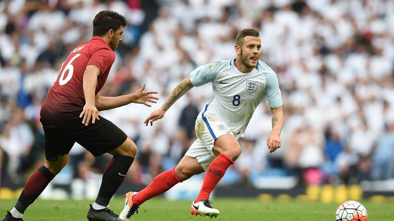 England's Jack Wilshere runs beyond Turkey's Ozan Tufan during the international friendly match at the Etihad Stadium on May 22, 2016