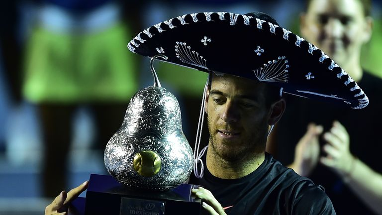 Juan Martin del Potro receives trophy after winning the Acapulco Open final against Kevin Anderson