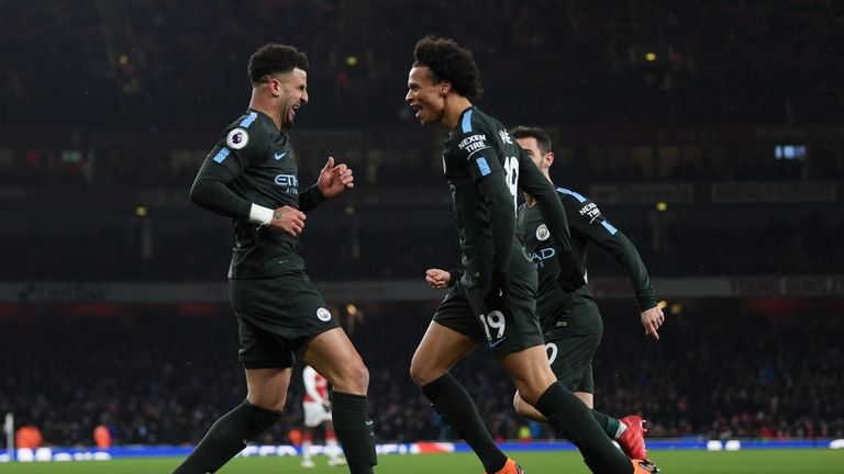 Leroy Sane celebrates with Kyle Walker after extending Manchester City's lead