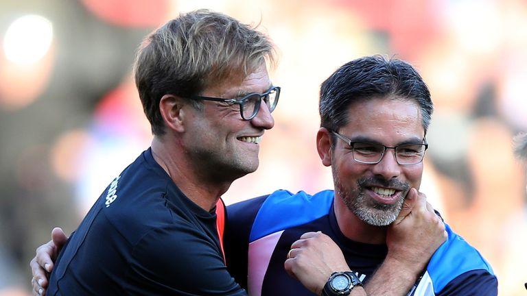 Liverpool manager Jurgen Klopp embraces best friend David Wagner of Huddersfield