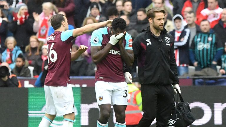 Michail Antonio leaves the pitch with his head in his hands after picking up an injury last weekend