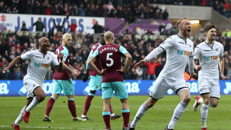Mike van der Hoorn doubles Swansea's lead at the Liberty Stadium