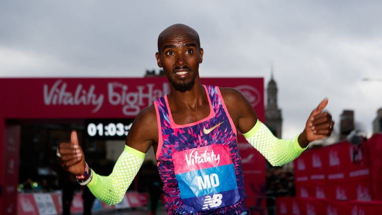 Mo Farah celebrates winning the 'Big Half' in London City Centre