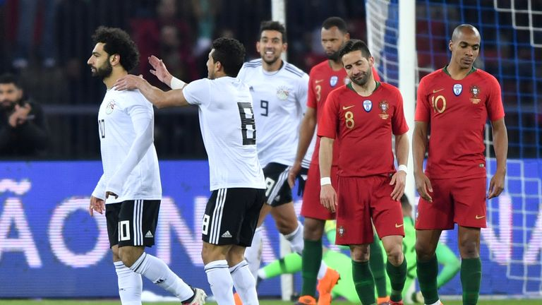 Egypt forward Mohamed Salah is congratulated after opening the scoring against Portugal