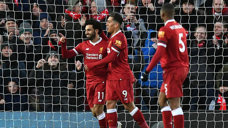 Salah celebrates scoring his second goal of the game with Firmino