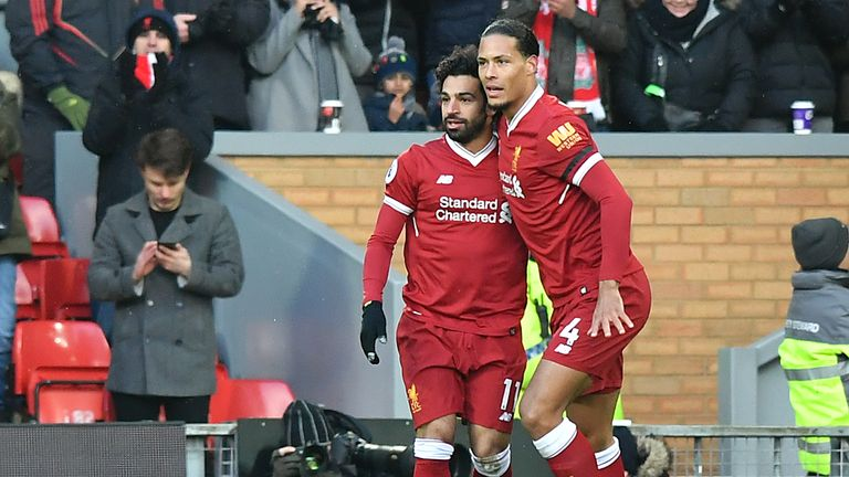 Mohamed Salah celebrates with Virgil van Dijk after scoring Liverpool's first goal v Watford during the Premier League match at Anfield, Liverpool. PRESS ASSOCIATION Photo. Picture date: Saturday March 17, 2018. See PA story SOCCER Liverpool. Photo credit should read: Anthony Devlin/PA Wire.