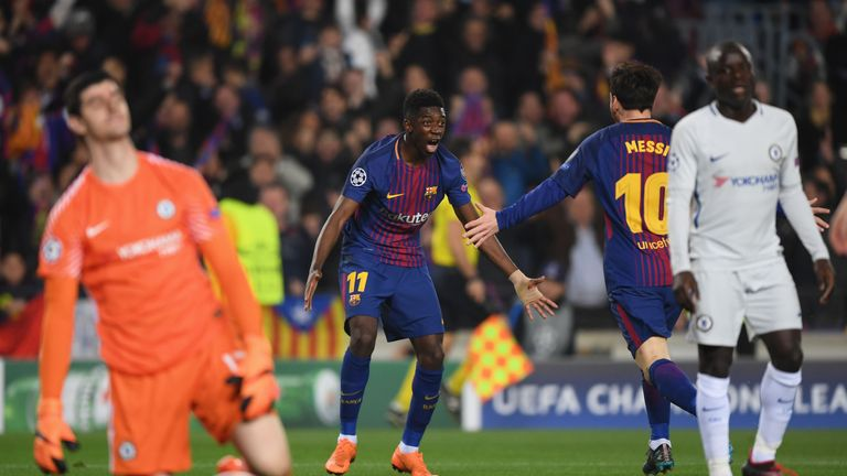 Ousmane Dembele celebrates with Lionel Messi after scoring Barcelona's second goal as Thibaut Courtois and N'Golo Kante look dejected